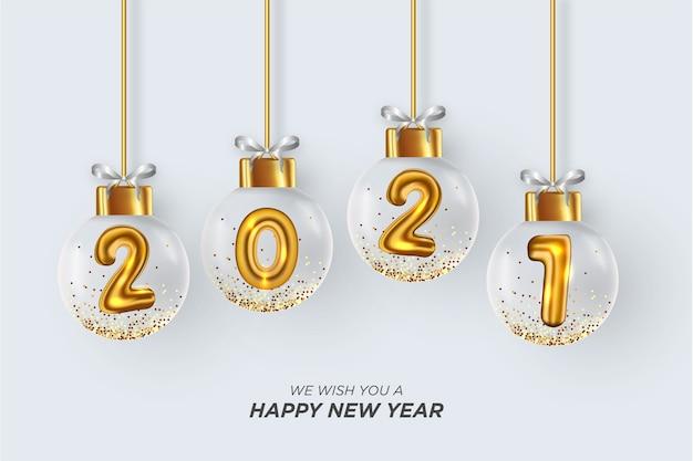 Ti auguriamo un felice anno nuovo card con realistiche palle di natale sfondo bianco