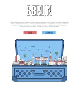 開いているスーツケースとベルリン市のwebテンプレート