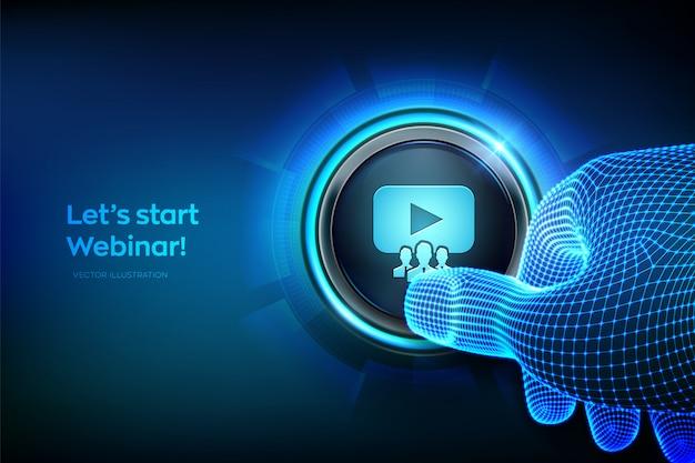ウェブセミナー。インターネット会議。 webベースのセミナー。ウェビナーのアイコンが付いたボタンを押しようとしている指のクローズアップ。