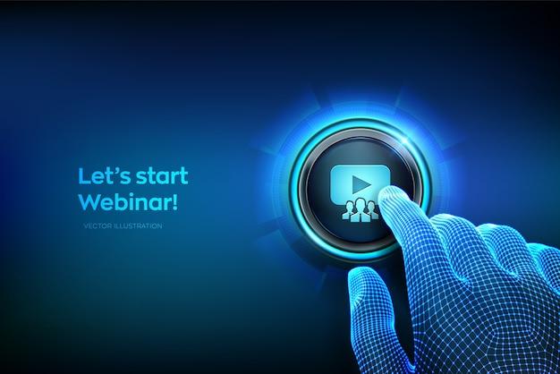 ウェブセミナー。インターネット会議。 webベースのセミナー。ウェビナーアイコンが付いたボタンを押しようとしている指のクローズアップ。