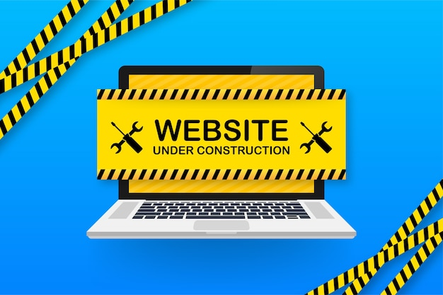Website under construction sign on laptop.