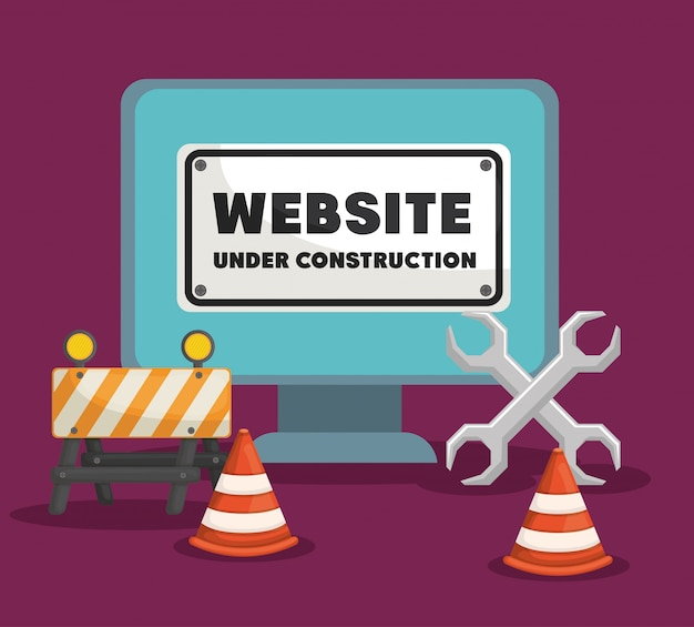 Website under construction with desktop computer