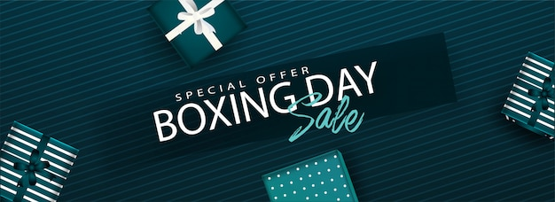 Website header or banner with boxing day sale text and top view of gift boxes decorated on green striped