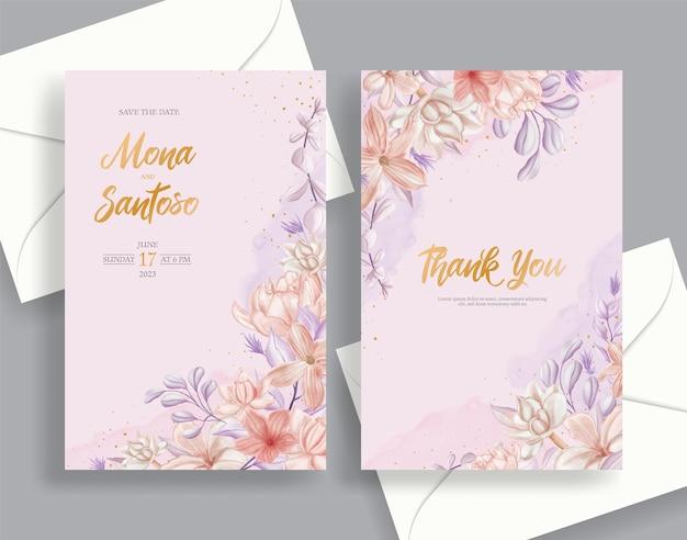 美しい花がセットされた結婚式の招待カードの文房具