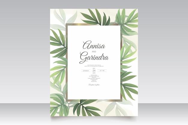 美しい熱帯の葉と結婚式の招待カードのテンプレート