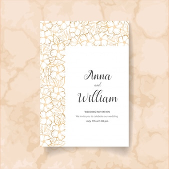 Wedding invitation card with golden flowers, leaves and branches