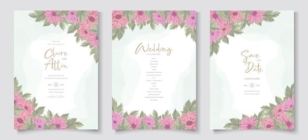 ピンクの菊の花のデザインが施された結婚式の招待状