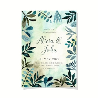 Wedding invitation card with watercolor green leaves abstract background