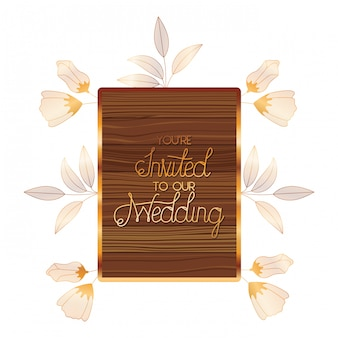 Wedding invitation in frame of wooden