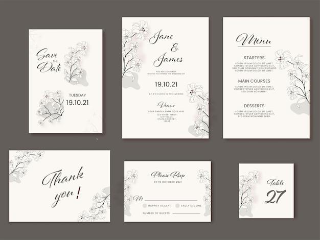 白い色のユリの花で飾られた結婚式の招待状スイート。