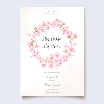 Wedding invitation template with cherry blossom wreath