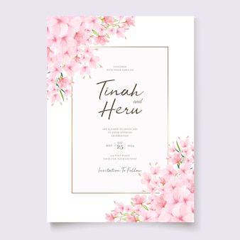 Wedding invitation template with cherry blossom wreath