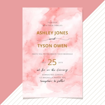 Wedding invitation with abstract blush watercolor background