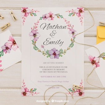 Wedding invitation with floral watercolor wreath Free Vector