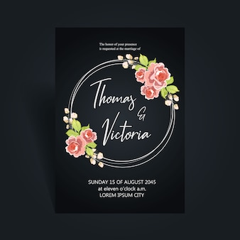 Wedding invitation with floral wreath on dark
