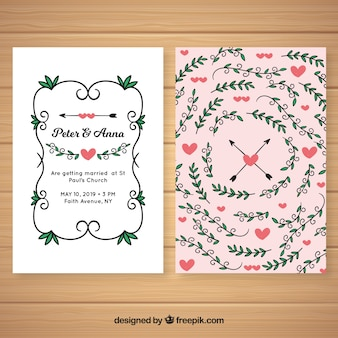 Wedding invitation with hand drawn hearts and leaves