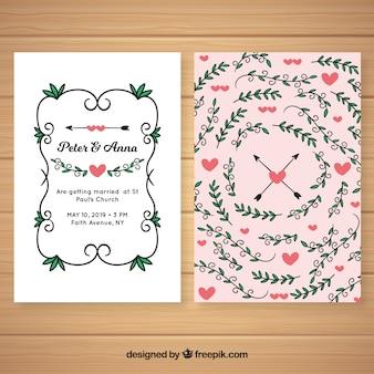 Invito a nozze con cuori e foglie disegnati a mano