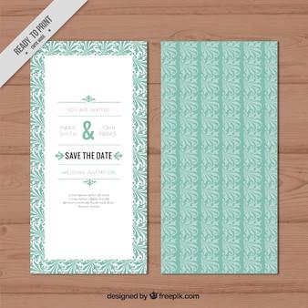 手描きの葉の装飾が施された結婚式の招待状