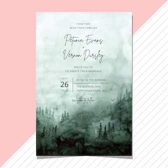 Wedding invitation with misty green forest watercolor background