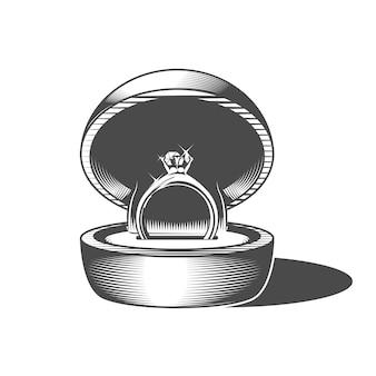 Обручальное кольцо в круглой подарочной коробке с драгоценным камнем