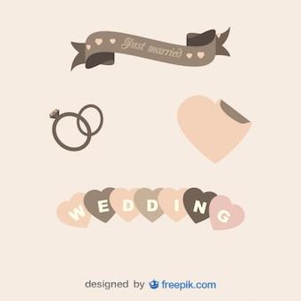 Wedding rings, ribbon and hearts