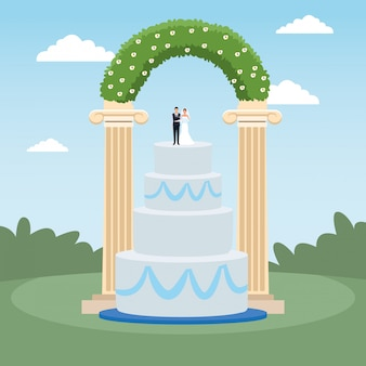 Weeding cake and floral arch over landscape