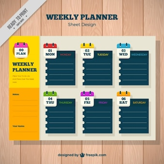 Weekly planner with paper notes