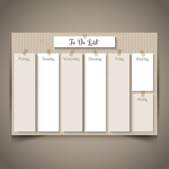 Weekly planner with a retro cardboard design Free Vector