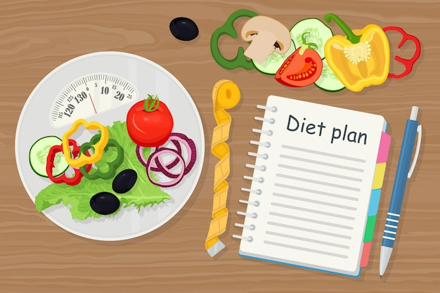 Weight loss concept. scales, vegetables and diet plan in a notebook. healthy eating, dieting