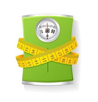 무게와 줄자. 체중 감소 및 건강 관리의 개념