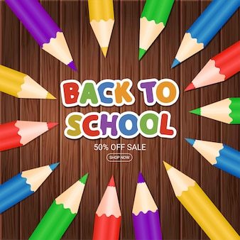 Welcome back to school.  poster with colorful pencils and  phrase on wooden background. sale banner