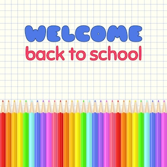 Welcome back to school. rainbow colored crayons in a line.