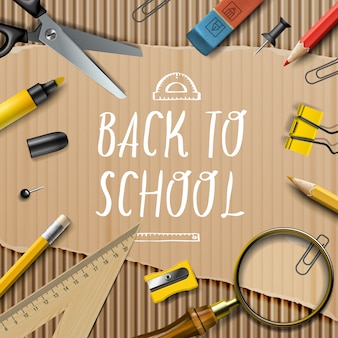Welcome back to school template with office supplies on cardboard texture background,