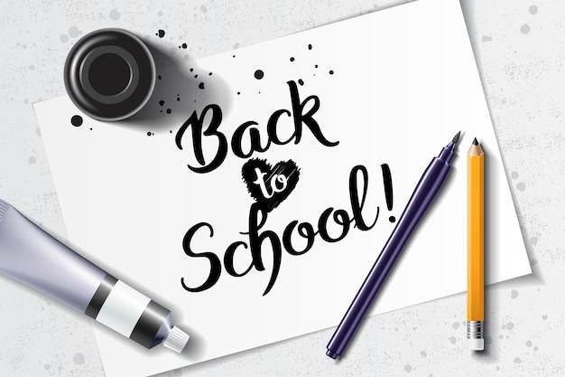 Добро пожаловать обратно в школу рисованной надписи с макетом каллиграфии с кистью