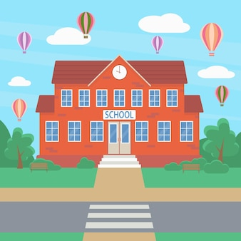 Welcome to school school building against the backdrop of green bushes trees and a hot air balloon