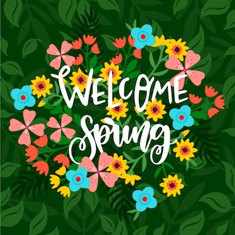 Welcome spring lettering with colorful flowers