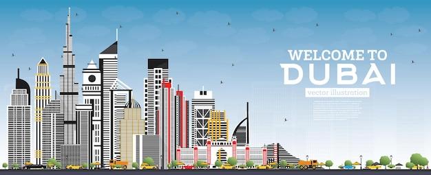 회색 건물과 푸른 하늘이있는 두바이 uae 스카이 라인에 오신 것을 환영합니다.