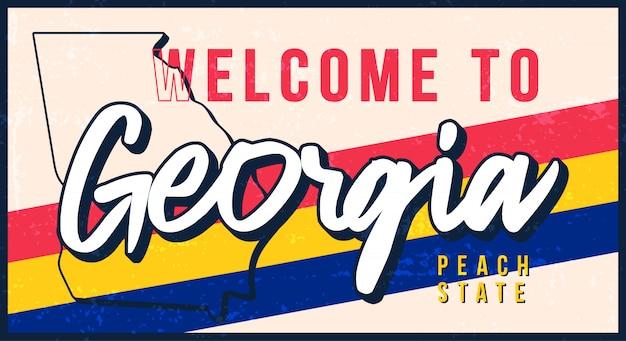 ジョージアヴィンテージさびた金属サインイラストへようこそ。タイポグラフィ手描きのレタリングとグランジスタイルの州地図。
