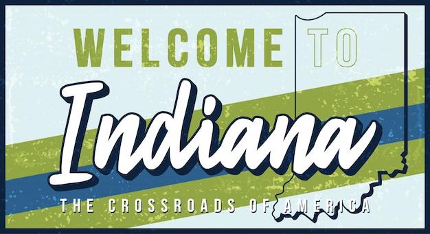 インディアナヴィンテージさびた金属サインイラストへようこそ。タイポグラフィ手描きのレタリングとグランジスタイルの州地図。