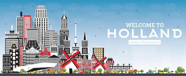 회색 건물과 푸른 하늘이 있는 네덜란드 스카이라인에 오신 것을 환영합니다.