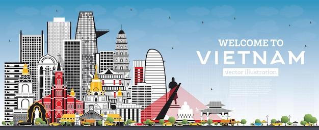 회색 건물과 푸른 하늘이 있는 베트남 스카이라인에 오신 것을 환영합니다. 벡터 일러스트 레이 션. 역사적인 건축과 관광 개념입니다. 랜드마크가 있는 베트남 풍경. 하노이. 호치민. 하이퐁. 다낭.