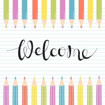 Цветные карандаши на листе тетради с рукописными надписью welcome.