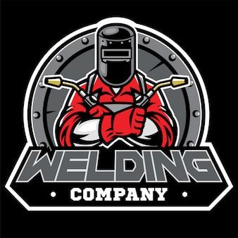Welder wearing welding helmet