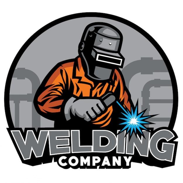 Welder working with weld helmet