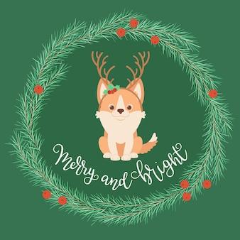 クリスマスの花輪の鹿の角のヘッドバンドを身に着けているウェールズコリの子犬
