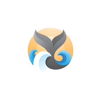 クジラの尾の波の海と太陽のロゴ