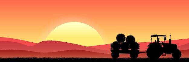 トラクターと干し草で夜の麦畑