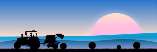 干し草と夕方の麦畑
