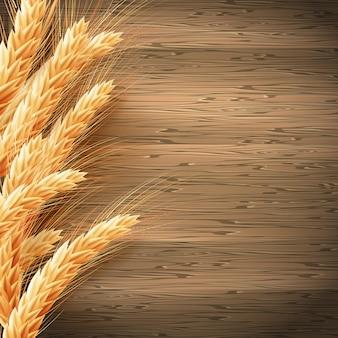 木材の背景に小麦。