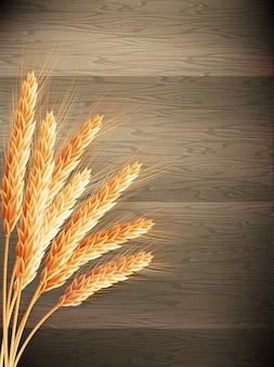 木製の背景に小麦。